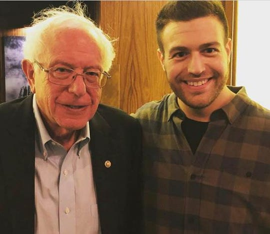 Presidential candidate Bernie Sanders with Empire Kitchen & Cocktails owner Aaron Lowen