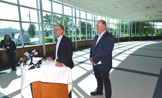 Democratic National Committee Chair Tom Perez, left, is joined by U.S. Rep. Dan Kildee during a press conference Tuesday across from GM's Warren Transmission plant.