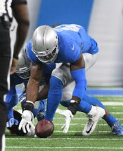 Lions linebacker Jarrad Davis recovers a fumble by Bears in a game last season. Detroit was 31st out of 32 teams in generating takeaways last season.
