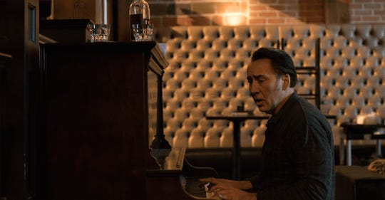 "Nicolas Cage in ""A Score to Settle."""