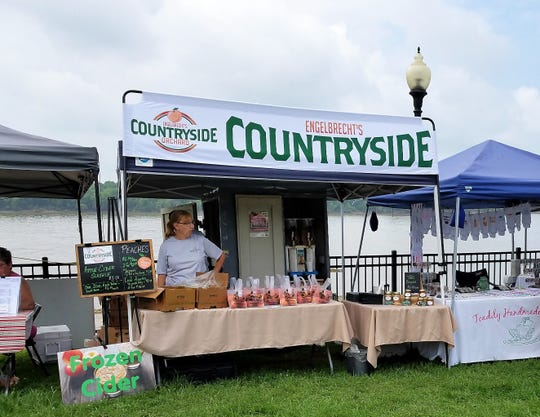 Engelbrecht's Countryside Orchard stand overflows with peaches at the Historic Newburgh Farmers Market on Saturday, June 22, 2019.