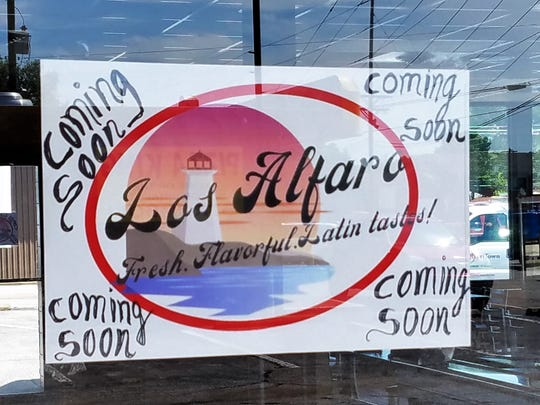 "A ""coming soon"" sign hangs in the window of Los Alfaro's new location on Weinbach Avenue on Friday, July 26, 2019"