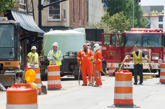 Vectren employees and Evansville Firefighters respond to a gas leak in Downtown Evansville on Northwest Second Street between Sycamore and Main streets Tuesday, July 30, 2019.