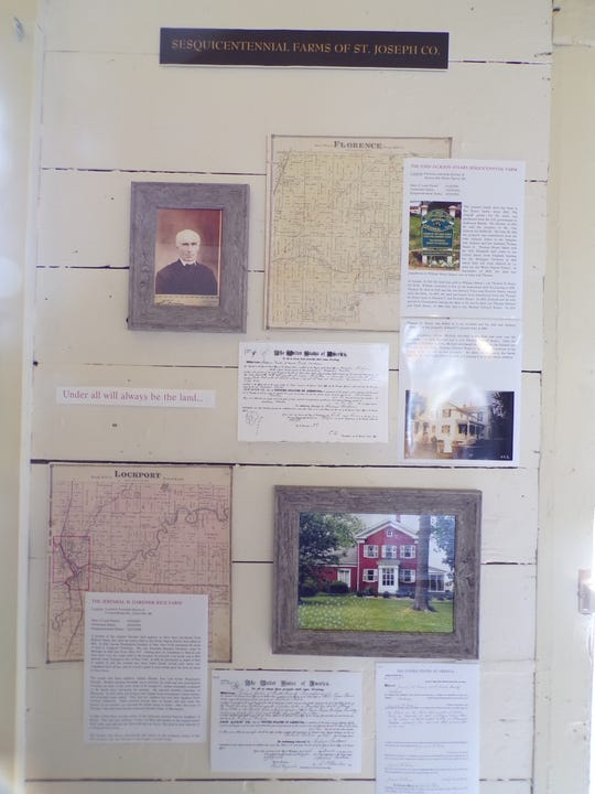 A display of information relating to sesquicentennial farms in the area is shown in the White Pigeon Prairie Land Office in White Pigeon, MI.