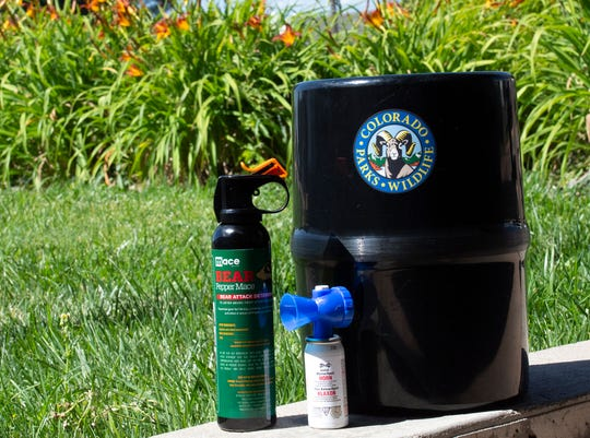 Bear spray, an air horn and bear canister can help keep you and your campsite safe.