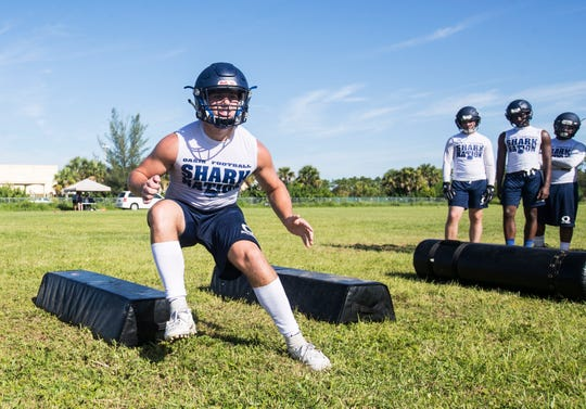 Tanner Rennie, the runningback/fullback at Oasis High School in Cape Coral practices with teammates on Tuesday July, 30, 2019. He along with his brother, Daniel lead the team.