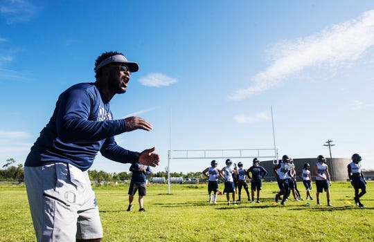 Mack Mitchell, the football coach at Oasis High School in Cape Coral encourages his players  on Tuesday July, 30, 2019.