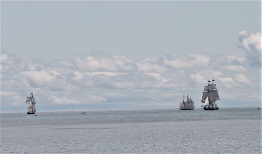 Three of the four tall ships taking part in the Great Lakes Challenge race in Lake Michigan are at full sail off Crescent Beach in Algoma before the start of the race.