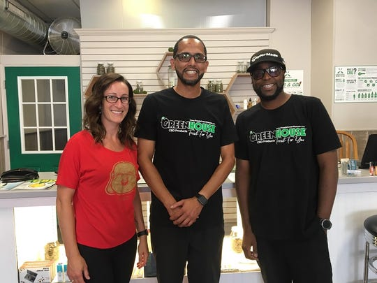 The employees of GreenHouse stand in front of some products. Sonja Anderson is the yoga instructor (left), Davijon Aguinaga is the manger (middle) and Andre Wagner (right) is the store owner.