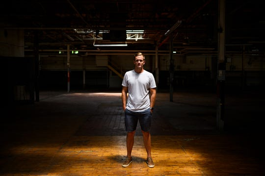 Developer Matt McPheely poses for a portrait inside an old warehouse building that will be converted into a mixed-use business space in the Poll Mill neighborhood Monday, July 30, 2019.