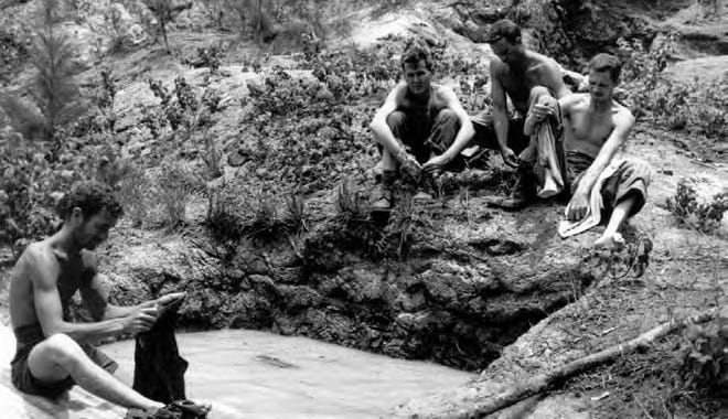 U.S. Army soldiers washing behind the defensive line on Guam.