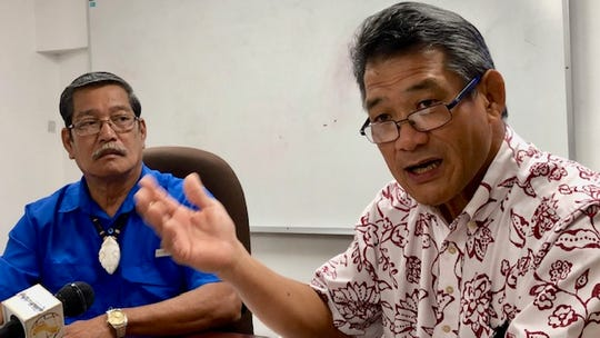Office of Finance and Budget Director Stephen Guerrero, right, gestures as he gets into the details of the fiscal 2020 budget bill, while bill author and appropriations committee chairman Sen. Joe San Agustin, left, looks on, at a news briefing on July 30, 2019 in Tamuning.