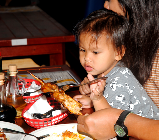 A new customer checks out Bacolod-style chicken.