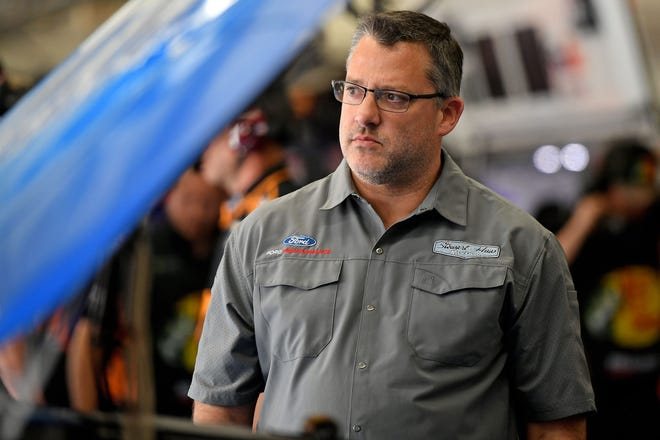 May 23, 2019; Concord, NC, USA; NASCAR Cup Series car owner Tony Stewart looks on in the garage during practice for the Coca-cola 600 at Charlotte Motor Speedway.