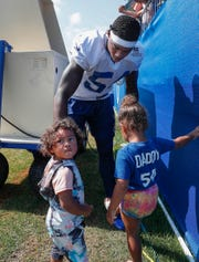 Indianapolis Colts linebacker Ahmad Thomas (54) greets his children Skylynn,right, and Ahmad II, left, during day 5 of the Colts preseason training camp practice at Grand Park in Westfield on Tuesday, July 30, 2019.