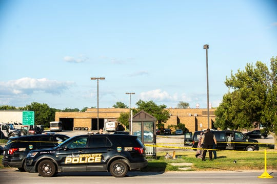 Iowa City police investigate at the scene of a shooting, Monday, July 29, 2019, near the Iowa City Transit System building and Sturgis Ferry Park in Iowa City, Iowa.