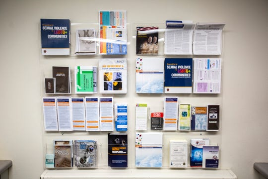 A display of informational pamphlets on sexual violence, assault, law enforcement/victim compensation and more is pictured, Tuesday, July 30, 2019, at the Police Department in Iowa City, Iowa.