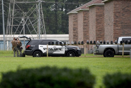 Jackson Police swat officers assisted in a domestic call and search warrant on North Highland, Tuesday morning, July 30.