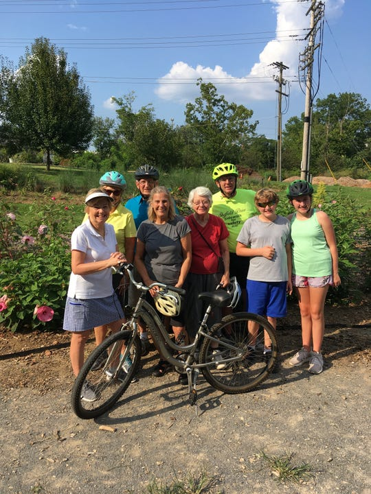 Several residents involved in the Healthy West Hills program that encourages exercise and healthy living recently rode their bikes the six miles on the city of Knoxville greenway paths to the UT Gardens and then back. From left are Fay Adams, Becky Herndon, Tim Crais, Anne Crais, Anne Ensor, Donnie Ernst, Nichols Ernst and Emily Ernst.