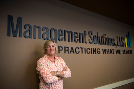 Misty Mayes, founder of Management Solutions LLC, poses for a photo in her Hardin Valley location Wednesday, July 10, 2019.