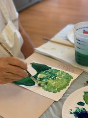During a recent Painting the Music class at the Opera House Gallery of Contemporary Art in Delphi, instructor Cheryl Kaldahl played instrumental piano music that inspired her students to paint with the color green.