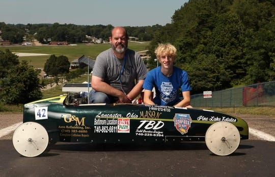 Lancaster's Mason Price poses with his father, Todd Barstow at the First Energy All-American Soap Box Derby in Akron. Price finished sixth overall in the Masters Division.