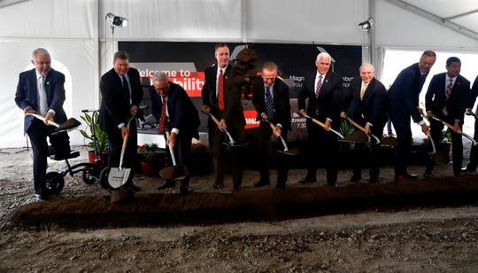 Local, state and federal dignitaries, including Vice President Mike Pence, fourth from right, join Magna International Donald Walker, fifth from left, in a ceremonial groundbreaking at future site the company's new manufacturing plant at the Rock Mill Industrial Park in Lancaster.