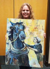 "Brighton Art Guild member Leah Kucharek holds ""Land Girls,"" a painting that will be featured in the guild's ""Winners Circle"" tent."