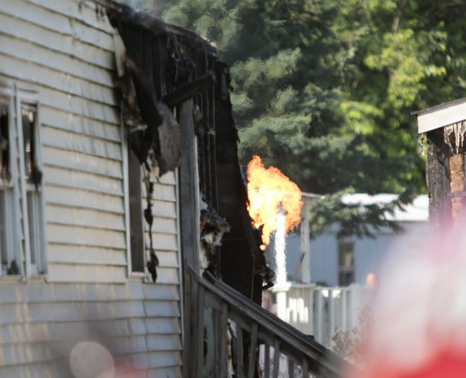 Propane continues to burn off from a tank ignited by a mobile home fire on Floreen Lane in Green Oak Twp. Tuesday, July 30, 2019. No one was injured in the fire.
