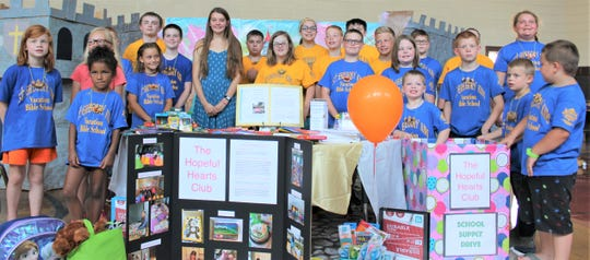Manitowoc Hopeful Hearts Club founder Lia Haile with St. Gregory Vacation Bible School participants.