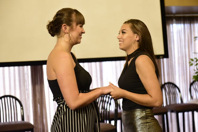 Ellie Nickoli, 16, left, and Emily Raff, 19, encourage one another as they wait to hear which of them won the Mansfield's Got Talent contest.