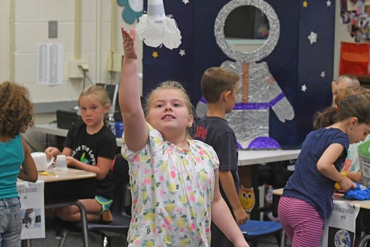 Aleah Rice, 7 years old, attached a coffee filter to a paper cup to simulate a space capsule and parachute during LEXplore Science Camp.