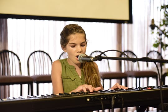 "Macy Page, 10, performs ""Bohemian Rhapsody"" by Queen during the Mansfield's Got Talent competition."