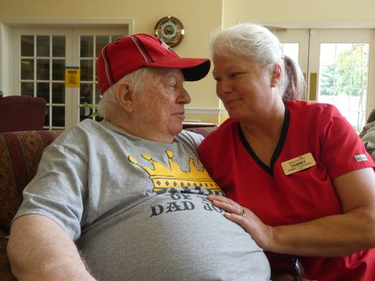 Carl Breece Sr., left, and daughter Tammy Zaworski, right, at the Memory Care day care at Kingston Residence of Marion. Breece, who has dementia, usually attends the day care four days a week, where Zaworski works as a cook.