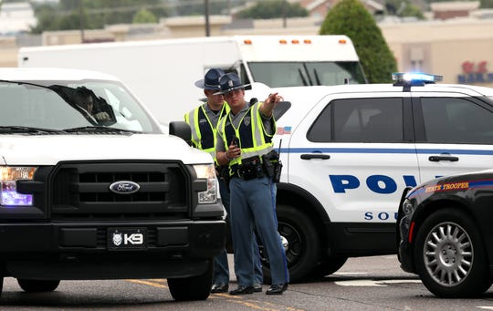 DeSoto County Sheriff's officers and Mississippi Highway Patrol officers respond to the Walmart in Southaven, Mississippi, following a shooting Tuesday morning, July 30, 2019, that killed two and injured two others.