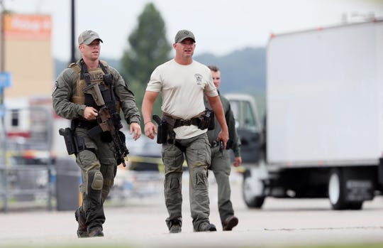 Members of the Southaven Police SWAT unit at the Walmart off Goodman Road following a shooting early Tuesday morning, July 30, 2019, that left two people dead.