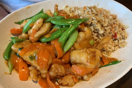 "The ""Pei Wei Original,"" with breaded chicken and cauliflower fried rice from Pei Wei, South Naples."