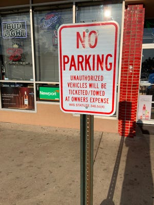 Grafton's temporary parking policy will reduce fines by 50% and ask that they be paid using canned goods donations.