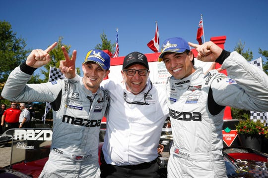 Oliver Jarvis (from left), Mazda motorsports director John Doonan and Tristan Nunez celebrate their victory at Canadian Tire Motorsports Park.
