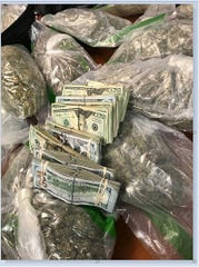 Milwaukee police recovered marijuana, cash and a handgun while executing a search warrant Monday in Milwaukee.