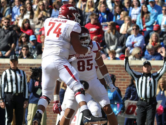 Arkansas Razorbacks offensive lineman Colton Jackson (74) and Arkansas Razorbacks tight end Cheyenne O'Grady (85) react after scoring a touchdown against the Mississippi Rebels at Vaught-Hemingway Stadium in this file photo.