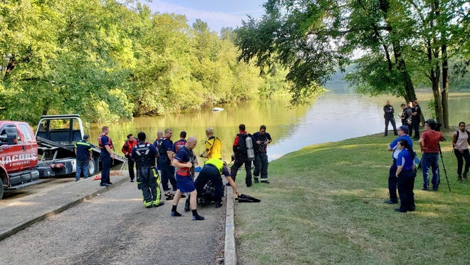 Montgomery fire rescue crews staged at a boat ramp in Powder Magazine Park to retrieve a white SUV from the Alabama River.