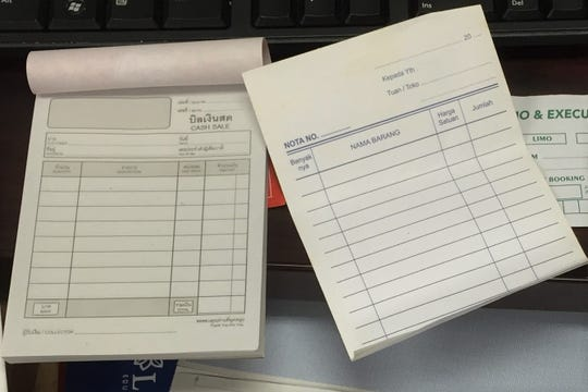 MTSU officials found blank receipt pads in Hasnugung's office after he was fired.