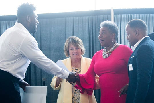 Brenda Gilmore reacts to a check for the NAACP Freedom Fund as she shakes Delanie Walker's hand with Titans controlling owner Amy Adams Strunk at Nissan Stadium Tuesday, July 30, 2019, in Nashville, Tenn.