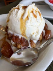 The warm cinnamon apple dessert at Southern Hospitality Diner in Nolensville, Tenn., features vanilla ice cream, a deep-fried Belgium waffle and caramel sauce