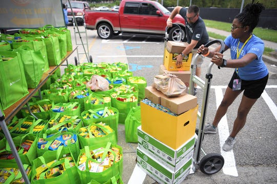 United Way's Dandrea Alexander unloads donated school supplies at Nissan Stadium on Tuesday, July 30, 2019 as part of United Way's Stuff the Bus campaign to provide backpacks to students in need from more than 14 local schools.