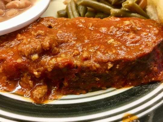 The meatloaf is tender and covered in a rich tomato sauce with just a hint of sweetness at Sisters meat-and-three in Dickson, Tenn.