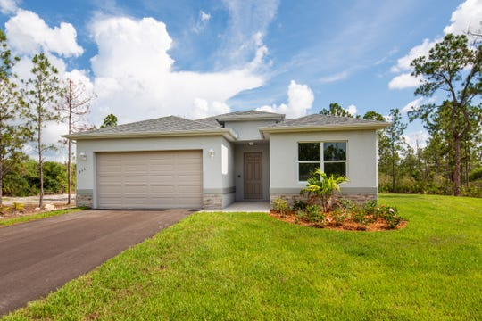 The Fiesta, a new three-bedroom plus den, two-bath home by FL Star on 2.5 acres in Golden Gate Estates.