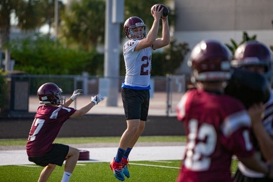 First Baptist Academy's Ty Cavaliere catches a pass during a football scrimmage, Tuesday, July 30, 2019, at First Baptist Academy in North Naples.