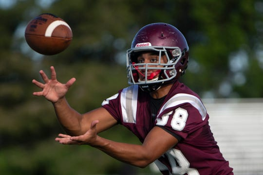 First Baptist Academy Erick Tello catches the ball during a football drill, Tuesday, July 30, 2019, at First Baptist Academy in North Naples.